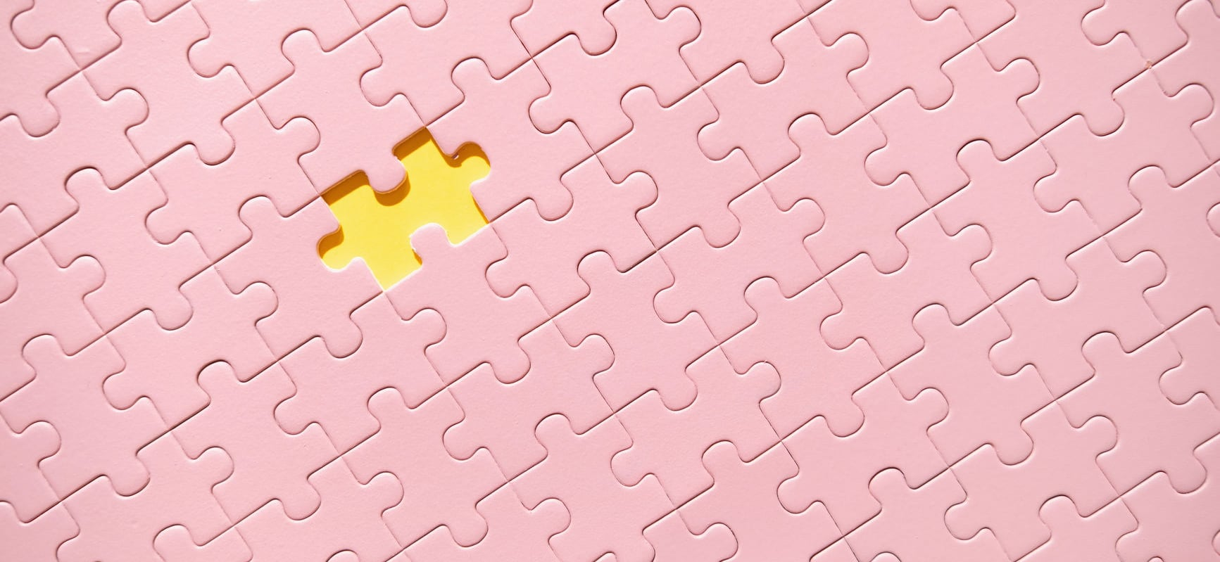 pink puzzle with a missing piece